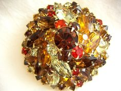 Gorgeous shades of autumn rhinestone brooch pin comes from the Ruby Lane Shop of Treasure Box Antiques.