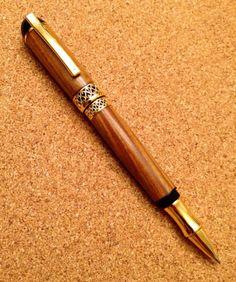 Lignum Vitae Gold Titanium Gel Pen by SPWoodArt on Etsy, $60.00