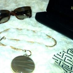 Authentic brown Versace Model #554-H & Necklace Authentic Gold/ Brown Versace Sunglasses Model # 544-H including Case & Cloth , including a gorgeous gold & Lucite round stone necklace. Versace Accessories Sunglasses