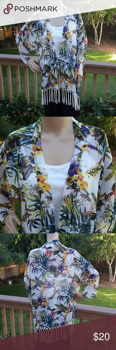 Carmen Marc Valvo Tropical Kimono Pretty, multi-colored, sheer, tropical-print kimono with tassels at bottom.  Kimono ties in front or you can leave it open. Only worn once so is in excellent condition. No signs of wear and tear.   White tank top not included.   Comes from a smoke-free home Carmen Marc Valvo Tops