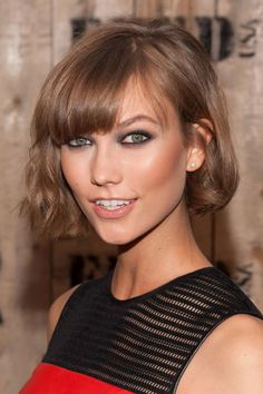 Ideal for hair that's slightly wavy, a bob that hits just above the chin frames the face without distracting from it.