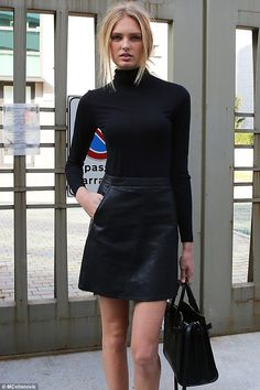 Model moment: The 20-year-old made quite the impact in a chic, monochrome ensemble, opting for a leather mini skirt which she styled with a black polo neck and two-tone sandals