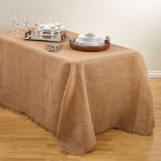 Dress your table in contemporary style with Saro Lifestyle's fringed burlap design tablecloths. These linens are perfect for everyday entertaining.