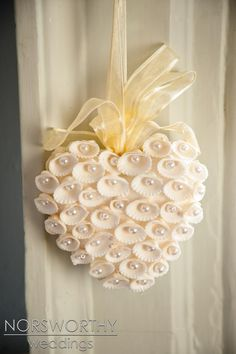 Pretty decoration for a wedding? Or paint shells red for Valentine's Day decoration? Seashell heart with pearls...