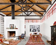 Garza Marfa founders Jamey and Constance Holt-Garza designed this 1,200-square-foot cinderblock house for a Los Angeles couple looking to establish roots in Marfa. The great room (shown) features dining and sleeping areas beneath exposed steel trusses that frame cypress ceilings and plaster walls.