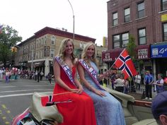 Lauren Benson (right), Miss Norway of Greater New York, and Britt Henricksen, Miss Heritage, ride the parade route in style.