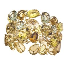 Exquisitely shaped and cut colored gemstones shine in Vianna's one of a kind bracelet. http://www.jewelista.com/products/18k-yellow-gold-gemstone-bracelet-616.aspx