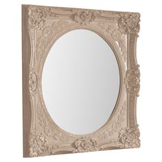 Showcasing an ornate medallion motif and scrolling floral accents in a glossy khaki-hued finish, this lovely wall mirror brings timeless elegance to your mas...