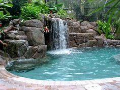 backyard-swimming-pools-with garden