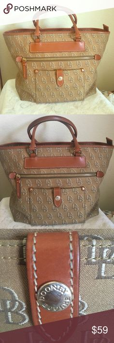 🆕 Dooney & Bourke signature logo purse (GUC!) Dooney & Bourke signature logo purse. Tan with DB logo and genuine Florentine Vacchetta leather. Top zipper and front zipper. Purse is in good, gently used condition. Bottom of purse does show signs of wear (see last pic) but overall no large stains, and all zippers work. Just some fabric pulling on bottom of purse in 4 edges, from being set down.  Price reflects the wear. 🌟🌟 Dooney & Bourke Bags Shoulder Bags