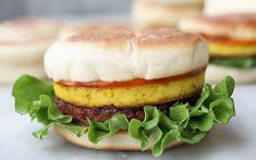 Breakfast Sandwich With Tofu Egg and Tempeh Sausage [Vegan] - One Green PlanetOne Green Planet High Protein Recipes, Vegan Recipes, Vegan Meals, Homemade English Muffins, Vegan Fast Food, Coconut Bacon, Marinated Tofu, Plant Based Breakfast, Tempeh