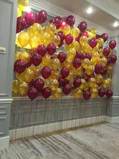 Nice balloon backdrop in burgundy and gold.