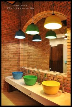 Funky colours. I like how the basins reflects the shape of the arched wall/mirror.