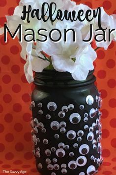 Easy Halloween craft for kids! The Halloween Mason Jar Vase is a quick and easy craft to make for your Halloween decor. Easy Halloween craft for kids! The Halloween Mason Jar Vase is a quick and easy craft to make for your Halloween decor. Halloween Crafts For Kids, Homemade Halloween, Diy Halloween Decorations, Halloween Ideas, Hanging Decorations, Halloween Parties, Halloween Stuff, Mason Jar Vases, Mason Jar Crafts