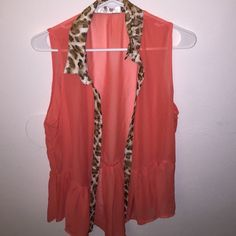 Button down blouse Never worn. In great condition. Doesn't have size on the tag. Looks like a small to me Tops Blouses