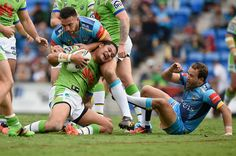 Joseph Leilua of the Canberra Raiders is tackled during the round 16 NRL match between the Gold Coast Titans and the Canberra Raiders at Cbus Super Stadium on June 26, 2016 in Gold Coast, Australia.