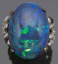I'm normally not a jewelry person (it makes me uncomfortable / scared of losing it if it has any value whatsoever).  However, I would make an exception for this ring of 27.63-carat black opal in 18kt gold with 22 diamonds.