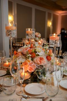 Something like this would be so pretty for a shorter centerpiece. And I do love the floating candles :)