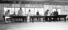 """Photo: UN delegate Lieut. Gen. William K. Harrison, Jr. (seated left), and Korean People's Army and Chinese People's Volunteers delegate Gen. Nam Il (seated right) signing the Korean War armistice agreement at P'anmunjŏm, Korea, 27 July 1953. Credit: F. Kazukaitis, U.S. Department of Defense; Wikimedia Commons. Read more on the GenealogyBank blog: """"Signing of Armistice Ends Korean War."""" https://blog.genealogybank.com/signing-of-armistice-ends-korean-war.html"""