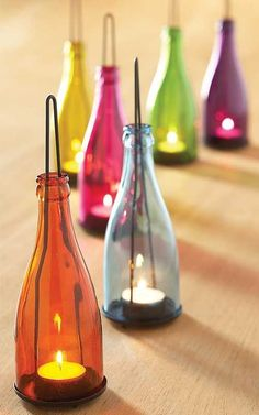 Best wine bottle recycling and repurposing ideas ever! This'd go great with my wine bottle wick candles! Old Wine Bottles, Bottle Candles, Wine Bottle Crafts, Bottles And Jars, Bottle Art, Bottle Lights, Wine Bottle Candle Holder, Bottle Lamps, Recycled Glass Bottles