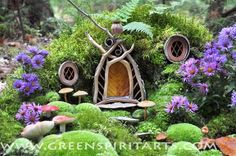 Fairy house with the golden door by Sally Smith.  // I bet you could make windows from metal bottle caps & gold door out of painted popsicle sticks