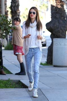 Light-wash jeans with a funky design give Alessandra Ambrosio a playful feeling