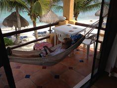 Books via IPAD, hammock and beach front view #akumal = Aweseome day! www.beachestx.com