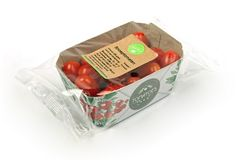 Tomatoes in tomato stems fibre reinforced cardboard packaging