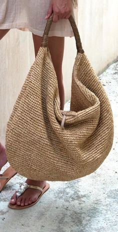 "Villahermosa | Raffia Bag XL raffia woven tote, with braided leather handle. Three internal pockets (one with zipper). Stylish, yet casual and practical.  Each piece is an original; any slight irregularities you might detect add character and integrity to the creation you have selected.  MEASUREMENTS:  19"" W x 17""h x 8d"""