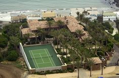 Cher (Malibu, CA) Cher's beachfront compound includes a private tennis court (and a LOT of palm trees).