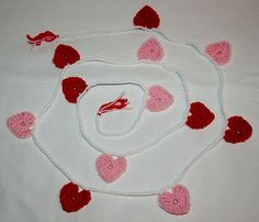 HAND CRAFTED CROCHET GARLAND W/ RED AND PINK HEARTS ON A WHITE ROPE AND TASSELS