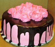so simple and elegant.. with edible glitter in the frosting and pretty flowers on top.