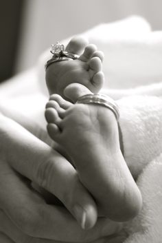 I'm pretty sure this is in the top ten most beautiful and original baby photos I have ever seen. (Newborn Feet with Wedding Bands)