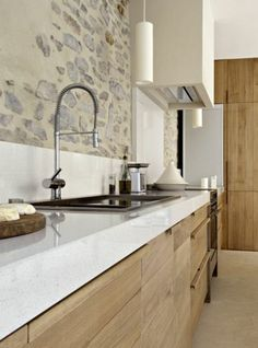 The stone bench and wooden kitchen cupboards