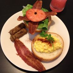 Open-faced EBLT Breakfast Sandwich. Gourmet scrambled eggs whipped with butter and seasoned with salt, pepper, paprika and Italian parsley for garnish... On a lightly buttered and toasted Kaiser roll with turkey bacon, Romaine lettuce, vine-ripe tomato with a side of turkey sausage links.  De-lish!