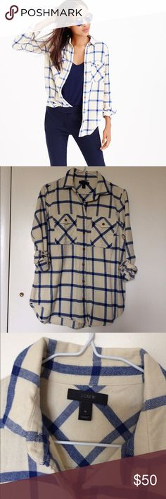 J. Crew Boyfriend Shirt in Rockport Plaid The perfect plaid flannel from J. Crew in cream and blue with brown button details. Incredibly soft with a comfortable fit, worn once, in perfect condition. J. Crew Tops Button Down Shirts