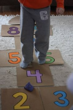 Make an easy, indoor hopscotch for rainy day fun. Cardboard, acrylic paints and a beanbag are all you need to make this indoor activity for kids. Field Day Games, Rainy Day Fun, Rainy Days, Happy Hooligans, Pizza Boxes, Indoor Activities For Kids, Counting Activities, Therapy Activities, Outdoor Activities