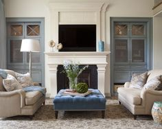 How gorgeous is the decor in this living area? The blue wall feature breaks up the white and fireplace feature. #home #decor #pinterest