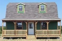 This site says how they bought a Tuff Shed from Lowe's and made a house out of it - You should really look into this B! - photo tuffshedcabin.jpg