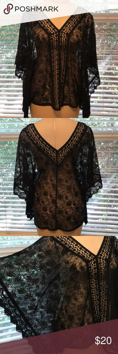 NWOT CANDIE'S Lace Poncho Blouse Top, Kimono XL New without tag Beautiful CANDIES Boho Hippie Lace Blouse Top V-neck and matching V-back Kimono, Batwing Sleeves Scallop lace edges with dainty floral flowers Color: black Fabric: 100% Polyester (stretch) Interior ribbon ties to hang Size: XL Candie's Tops