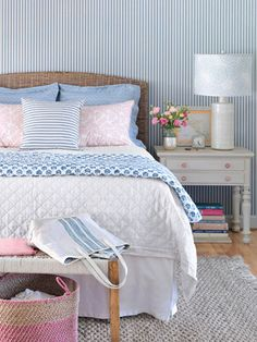 Don't underestimate the value of soft-spoken accents. Here, pale pink pillow shams and glass knobs play an important supporting role to the bedroom's blue-and-white foundation.