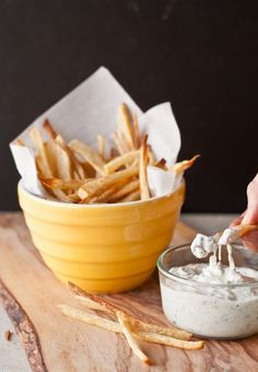 These spicy oven baked french fries are seasoned with cumin and cayenne pepper and served with a refreshing cucumber raita sauce.