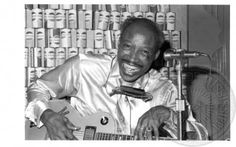 Jimmy Reed  A personal story: My husband knew Jimmy. He would get so drunk, he couldn't remember the words to his songs. His wife would stand next to him on stage and when he'd forget the words, she would whisper them to him.