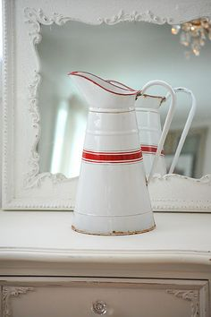 red and white enamelware pitcher, cool painted mirror and dresser...nice  #dining #diningroom #diningdecor #homedecor #red