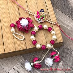 Preety Crafted Pink Roses Studded Pearl Wrist Ring Bracelet Lumba With Diamond Look Zardosi Rakhi Rakhi Bracelet, Ring Bracelet, Bracelet Making, Handmade Rakhi Designs, Handmade Jewelry Designs, Gift For Raksha Bandhan, Rakhi Images, Bridal Jewelry, Beaded Jewelry
