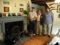 "In the Tavern Room of the Austin Roe House (1705), one of the centers of intelligence and espionage during the Revolutionary War.  Pictured are LI Spy Museum CEO Burke Liburt (center) with ""Bo"" Roberts (left), video photographer and Erich Frazier (right), history research analyst, both of The Angelo Group.    From 1776-1780 Captain Roe traveled between Setauket and NY as the provisioner & owner of the Tavern, but carried coded messages which were ferried across the Sound to Washington's HQ ."