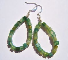 Tear drop earrings green moss agate cubed gemstones on silver wire These beautiful earrings are made of delicate moss green agate cubes (4mm) on silver plated wire and ear hooks. Just under 2.5 in length