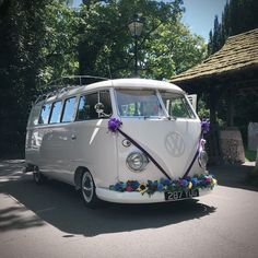 Boho style camper van adorned with brightly jewel coloured flowers for today's wedding in West Sussex. Shire Peggy Campervan wedding car for your special day. Wedding Car Decorations, Jewel Colors, Wedding Hire, Vintage Weddings, Vw Camper, Campervan, Surrey, Boho Style, Vans