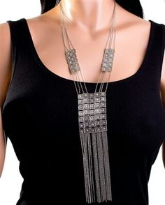 TRIABAL METALLIC FRINDGED NECKLACE-                                  Need to add a little interest to that basic black shirt? We have just the thing. Our draped chain fringed necklace with metallic linked square plates is sure to be a converstion starter.  Price: $14.00