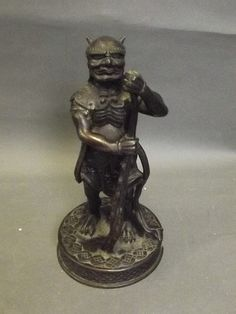 Description: A Japanese bronze figure in the form of a beast warrior, 8'' high
